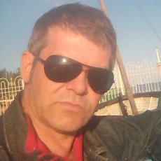 Фотография мужчины Gaddafi, 43 года из г. Волхов